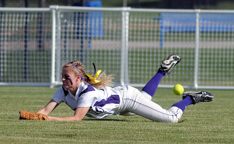 Holy Family's McKenzie Zeman nearly catches a fly ball from Berthoud during the state softball tournament at the Aurora Sparts Park on Friday.<br /> October 21, 2011<br /> staff photo/ David R. Jennings
