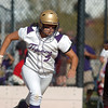 Holy Family's Alejandra Sullivan runs to frist base after bunting the ball against Berthoud during the state softball tournament at the Aurora Sparts Park on Friday.<br /> October 21, 2011<br /> staff photo/ David R. Jennings