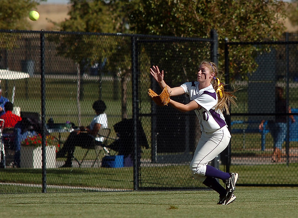 Hoy Family's McKenzie Zeman catches a flyball from Berthoud during the state softball tournament at the Aurora Sparts Park on Friday.<br /> October 21, 2011<br /> staff photo/ David R. Jennings