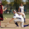 Holy Family's second baseman Grace Peterson reaches for the ball while Berthoud's Miranda Kamakele runs to second base during the state softball tournament at the Aurora Sparts Park on Friday.<br /> October 21, 2011<br /> staff photo/ David R. Jennings