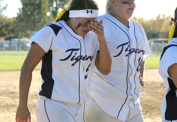 Holy Family's Alejandra Sullivan, left, and Caitlyn Krenz are upset over the loss to Berthoud in the state softball tournament at the Aurora Sparts Park on Friday.<br /> October 21, 2011<br /> staff photo/ David R. Jennings