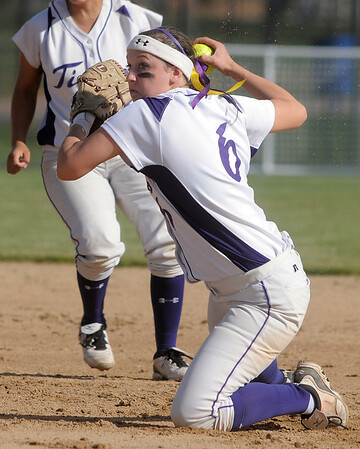 Holy Family's second baseman Grace Peterson throws to home after catching a ground ball by Berthoud's  during the state softball tournament at the Aurora Sparts Park on Friday.<br /> October 21, 2011<br /> staff photo/ David R. Jennings
