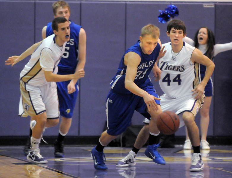 BE0203boy11<br /> Broomfield's Dakota Smith drives the ball down court against Holy Family during Saturday's cross town game at Holy Family.<br /> <br /> January 29, 2011<br /> staff photo/David R. Jennings