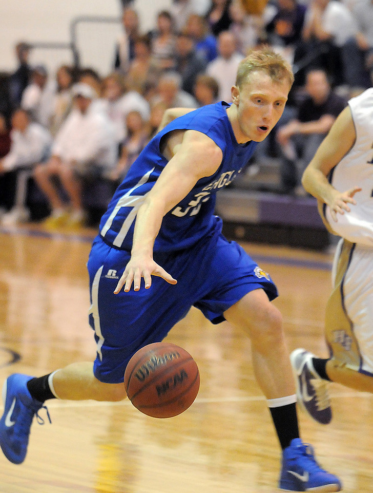 Broomfield's Dakota Smith drives down court against Holy Family during Saturday's cross town game at Holy Family.<br /> <br /> January 29, 2011<br /> staff photo/David R. Jennings
