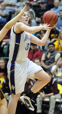 Holy Family's Sierra Williamson trows to an ope player against Brush during the 3A Great Eight game at CSU's Moby Gym in Ft. Collins on Thursday. <br /> <br /> <br /> March 10, 2010<br /> Staff photo/David R. Jennings