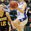Holy Family's Taylor Helbig goes in for a lay-up past Brush's Alicia Nichols during the 3A Great Eight game at CSU's Moby Gym in Ft. Collins on Thursday. <br /> <br /> <br /> March 10, 2010<br /> Staff photo/David R. Jennings