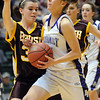Holy Family's Taylor Helbig drives to the basket against Brush during the 3A Great Eight game at CSU's Moby Gym in Ft. Collins on Thursday. <br /> <br /> <br /> March 10, 2010<br /> Staff photo/David R. Jennings
