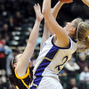 Holy Family's Stephanie Giltner fights to the basket against Brush players during the 3A Great Eight game at CSU's Moby Gym in Ft. Collins on Thursday. <br /> <br /> <br /> March 10, 2010<br /> Staff photo/David R. Jennings