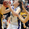 Holy Family's Kassandra Johnnsen drives to the basket through Brush players during the 3A Great Eight game at CSU's Moby Gym in Ft. Collins on Thursday. <br /> <br /> <br /> March 10, 2010<br /> Staff photo/David R. Jennings