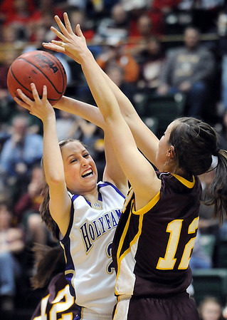 Holy Family's Sarah Talamantes fights to get the ball to the basket against Brush's Aicia Nichols during the 3A Great Eight game at CSU's Moby Gym in Ft. Collins on Thursday. <br /> <br /> <br /> March 10, 2010<br /> Staff photo/David R. Jennings