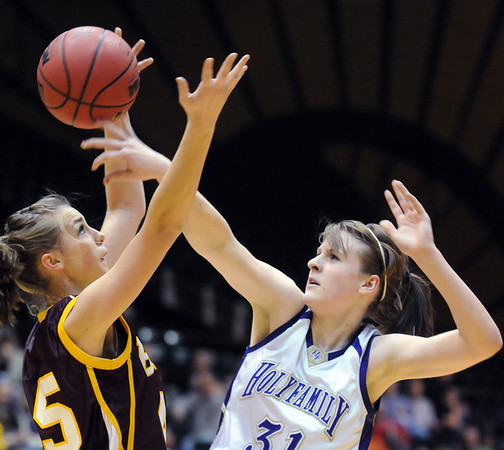 Holy Family's Kassandra Johnannsen shoots through the arms of Brush's Christine Dreitz during the 3A Great Eight game at CSU's Moby Gym in Ft. Collins on Thursday. <br /> <br /> <br /> March 10, 2010<br /> Staff photo/David R. Jennings