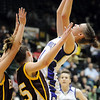 Holy Family's Taylor Helbig shoots over Brush players during the 3A Great Eight game at CSU's Moby Gym in Ft. Collins on Thursday. <br /> <br /> <br /> March 10, 2010<br /> Staff photo/David R. Jennings