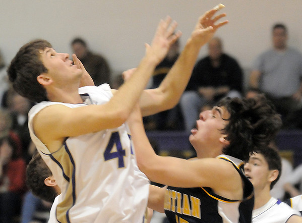 Holy Family's Kyle Willis goes to the basket against Colorado Springs Christian's Reagan Chapman during Saturday's game at Holy Family.<br /> <br /> December 17, 2011<br /> staff photo/ David R. Jennings