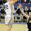 Holy Family's David Sommers shoots the ball against Colorado Springs Christian during Saturday's game at Holy Family.<br /> <br /> December 17, 2011<br /> staff photo/ David R. Jennings