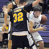Holy Family's Kyle Willis dribbles the ball against Colorado Springs Christian's Nick Bruns during Saturday's game at Holy Family.<br /> <br /> December 17, 2011<br /> staff photo/ David R. Jennings