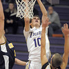 """Holy Family's Tanner Stuhr makes a basket against Colorado Springs Christian during Saturday's game at Holy Family.<br /> For more photos please see  <a href=""""http://www.broomfieldenterprise.com"""">http://www.broomfieldenterprise.com</a><br /> December 17, 2011<br /> staff photo/ David R. Jennings"""