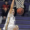 Holy Family's Tanner Stuhr makes sure the ball goes to the basket against Colorado Springs Christian during Saturday's game at Holy Family.<br /> <br /> December 17, 2011<br /> staff photo/ David R. Jennings