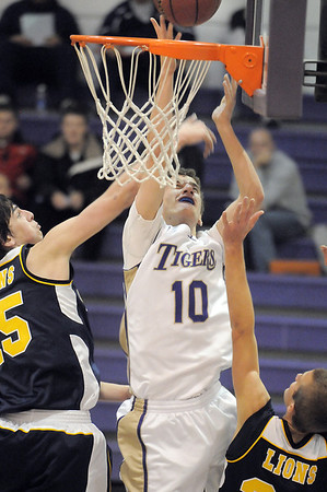 Holy Family's Tanner Stuhr makes a basket against Colorado Springs Christian during Saturday's game at Holy Family.<br /> <br /> December 17, 2011<br /> staff photo/ David R. Jennings
