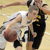 Holy Family's AJ Middleton drives the ball down court against Colorado Springs Christian's Kyle Broekhuis during Saturday's game at Holy Family.<br /> <br /> December 17, 2011<br /> staff photo/ David R. Jennings