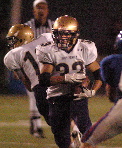 Holy Family's Clay Connor  runs through the Centaurus line during Friday's game at Centaurus High in Lafayette.<br /> <br /> September 24, 2010<br /> staff photo/David R. Jennings