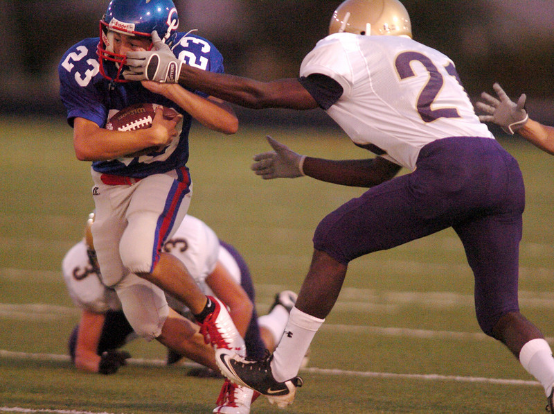 Centaurus' Tanner Martinelli avoids a tackle by Holy Family's Thomas Williams during Friday's game at Centaurus High in Lafayette.<br /> <br /> September 24, 2010<br /> staff photo/David R. Jennings