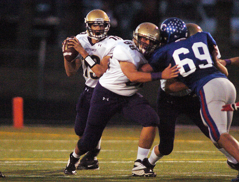 Holy Family's quarterback Zach Langfield looks for an open receiver during Friday's game against Centaurus  at Centaurus High in Lafayette.<br /> September 24, 2010<br /> staff photo/David R. Jennings