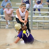 Holy Family's Amy Baumberger slides to home plate avoiding Chatfield High's pitcher Lexi Love during play at Holy Family on Tuesday.<br /> <br /> August 25, 2009<br /> staff photo/David R. Jennings