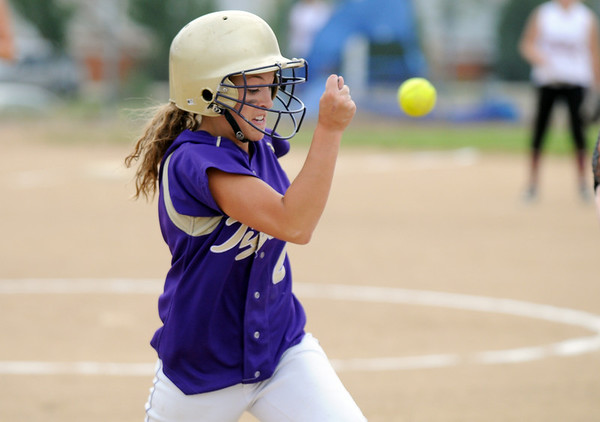Holy Family's Beth Peterson tries to beat the ball to first base during play against Chatfield High at Holy Family on Tuesday.<br /> <br /> August 25, 2009<br /> staff photo/David R. Jennings