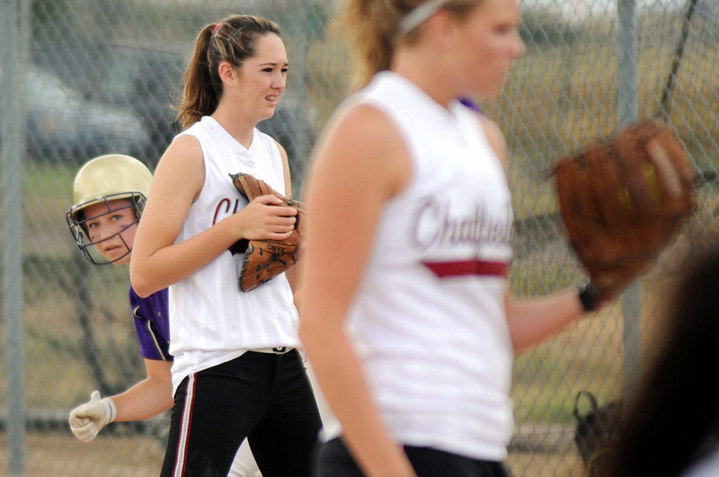 Holy Family's Daiva Jarasius peeks around Chatfield High's first baseman Reiki Mint to the pitcher Lexi Love during play at Holy Family on Tuesday.<br /> <br /> August 25, 2009<br /> staff photo/David R. Jennings