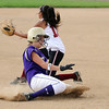 Holy Family's Amy Baumberger safely slides to 3rd base past Chatfield High's Rene Tenrio during play at Holy Family on Tuesday.<br /> <br /> August 25, 2009<br /> staff photo/David R. Jennings