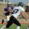 Holy Family's quarterback David Sommers gets ready to pass during Thursday's game at Michael Gabriel Stadium.<br /> September 15, 2011<br /> staff photo/ David R. Jennings