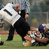 Holy Family's Garrett West tackles Conifer's AJ Eleniewski during Thursday's game at Michael Gabriel Stadium.<br /> September 15, 2011<br /> staff photo/ David R. Jennings