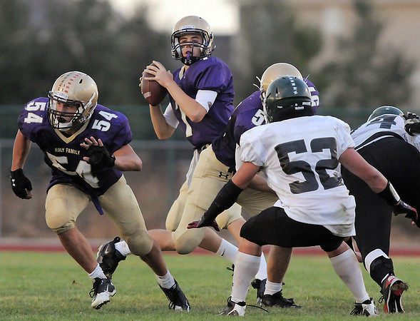 Holy Family's quarterback David Sommers looks for an open  receiver  during Thursday's game against Conifer at Michael Gabriel Stadium.<br /> September 15, 2011<br /> staff photo/ David R. Jennings