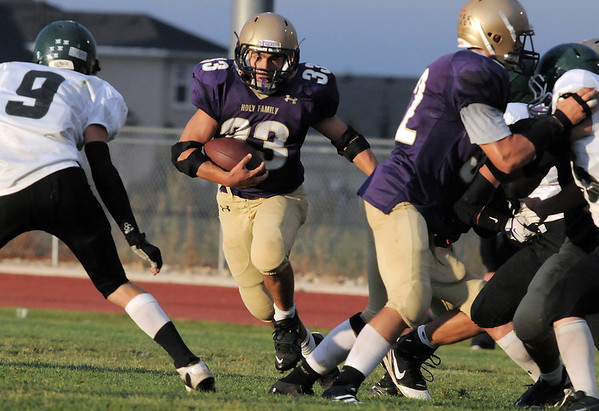 Holy Family's Connor Clay runs downfield against Conifer during Thursday's game at Michael Gabriel Stadium.<br /> September 15, 2011<br /> staff photo/ David R. Jennings