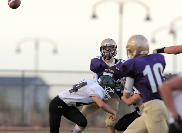 Holy Family's quarterback David Sommers passes to Colin McGillin during Thursday's game against Conifer at Michael Gabriel Stadium.<br /> September 15, 2011<br /> staff photo/ David R. Jennings