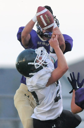 Holy Family's Scout Cox breaks up a pass intended for Conifer's Patrick Marshall during Thursday's game at Michael Gabriel Stadium.<br /> September 15, 2011<br /> staff photo/ David R. Jennings