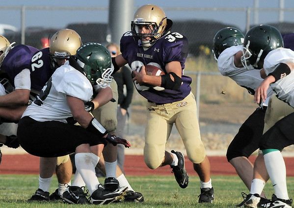 Holy Family's Connor Clay runs through a hole in the line during Thursday's game at Michael Gabriel Stadium.<br /> September 15, 2011<br /> staff photo/ David R. Jennings