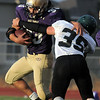 Holy Family's Connor Clay is tackled by Conifer's Jay Moody during Thursday's game at Michael Gabriel Stadium.<br /> September 15, 2011<br /> staff photo/ David R. Jennings