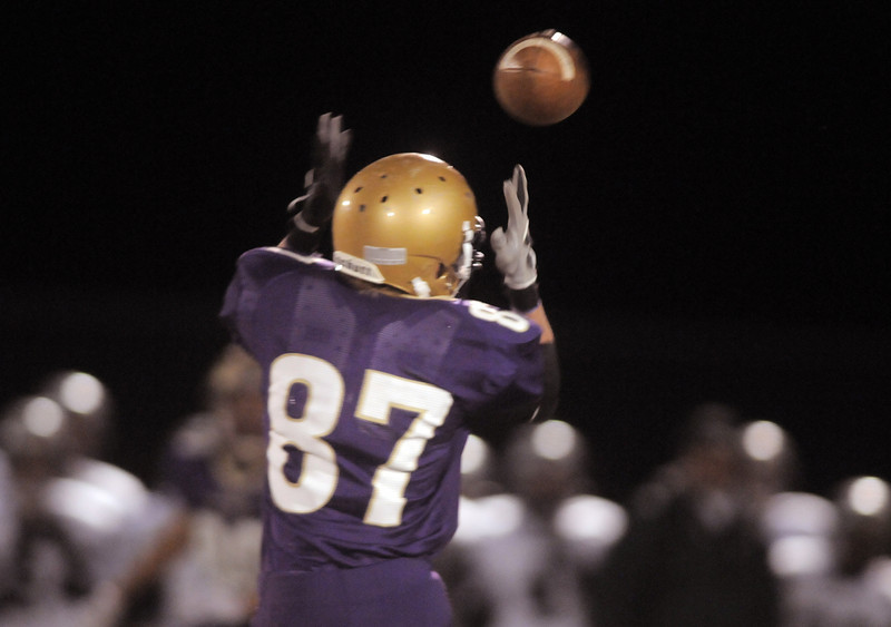 Holy Family's Tommy Erb reaches for a pass during Friday's game against D' Evelyn at Michael G. Gabriel Stadium.<br /> October 29, 2010<br /> staff photo/David R. Jennings
