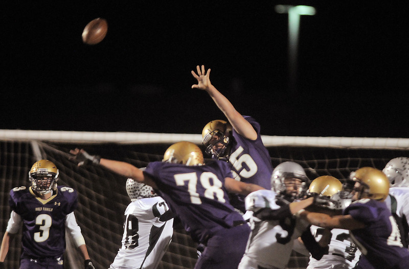 Holy Family diverts an extra point kick by D' Evelyn during Friday's game at Michael G. Gabriel Stadium.<br /> October 29, 2010<br /> staff photo/David R. Jennings