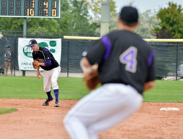 Devlin Granberg, Holy Family, prepares to throw to Garrett West at first baseto tag out an Eaton player during the state 3A semi-final game at Butch Butler Field in Greeley on Friday.<br /> <br /> May 25, 2012 <br /> staff photo/ David R. Jennings