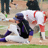 Jacob Tinnon, Holy Family, slides safely to homeplate against Eaton's Ryan Lawhead during the state 3A semi-final game at Butch Butler Field in Greeley on Friday.<br /> <br /> May 25, 2012 <br /> staff photo/ David R. Jennings