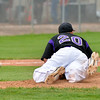 Pitcher Zach Tombley, Holy Family, falls from the mound after beign hit by an Eaton ball during the state 3A semi-final game at Butch Butler Field in Greeley on Friday.<br /> <br /> May 25, 2012 <br /> staff photo/ David R. Jennings