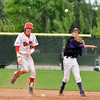 Holy Family's Louis Simpson throws to second base after tagging out Jake Nelson, Eaton during the state 3A semi-final game at Butch Butler Field in Greeley on Friday.<br /> <br /> May 25, 2012 <br /> staff photo/ David R. Jennings