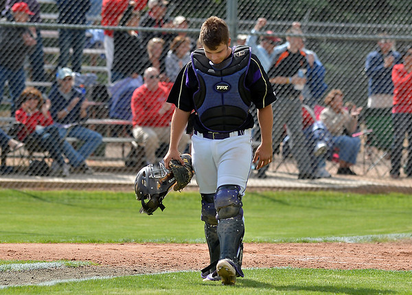 Holy Family's catcher Chris McManuswalks off of the diamond after the Tigers lost to Eaton 12-2 in the state 3A semi-final game at Butch Butler Field in Greeley on Friday.<br /> <br /> May 25, 2012 <br /> staff photo/ David R. Jennings