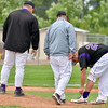 Pitcher Zach Trombley, Holy Family, right, lifts his pant leg for his coaches after he was hit by an Eaton ball during the state 3A semi-final game at Butch Butler Field in Greeley on Friday.<br /> <br /> May 25, 2012 <br /> staff photo/ David R. Jennings
