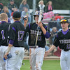 Devlin Granberg, Holy Family, is congratulated by teammates after scoring a run against Eaton during the state 3A semi-final game at Butch Butler Field in Greeley on Friday.<br /> <br /> May 25, 2012 <br /> staff photo/ David R. Jennings