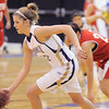 Stephanie Giltner, Holy Family, drives the basketball up court against Eaton during Tuesday's game at Holy Family.<br /> January 4, 2011<br /> staff photo/David R. Jennings