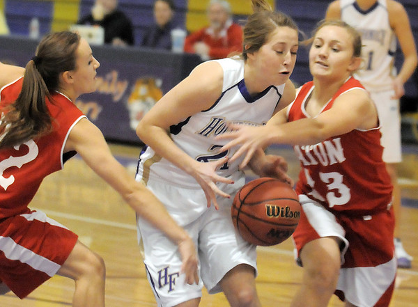 Holy Family's Sarah Talamantes fights for control of the ball with Beth Cheney and Kayla Cheney, Eaton during Tuesday's game at Holy Family.<br /> January 4, 2011<br /> staff photo/David R. Jennings