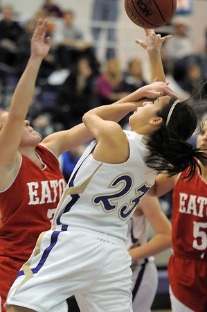 Carolina Gutierrez, Holy Family, fights her way to the basket against Eaton players during Tuesday's game at Holy Family.<br /> January 4, 2011<br /> staff photo/David R. Jennings